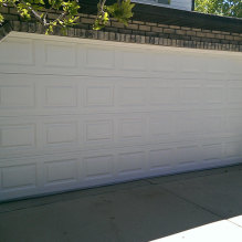 White shed door with truck
